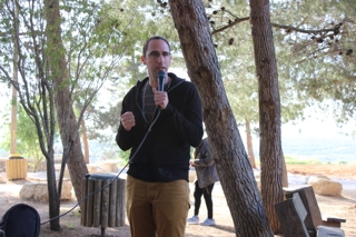 Gil talking to the group in Shilo